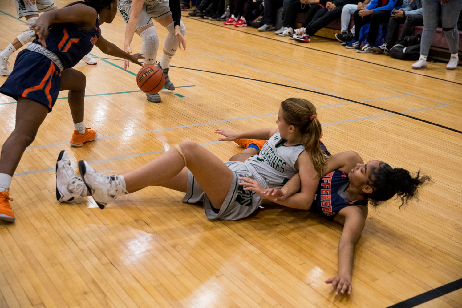 Bronx Science's Lillian Flynn hits the floor to battle for a loose ball during the Wolverines' 41-34 victory over Jefferson in a PSAL playoff game last week.