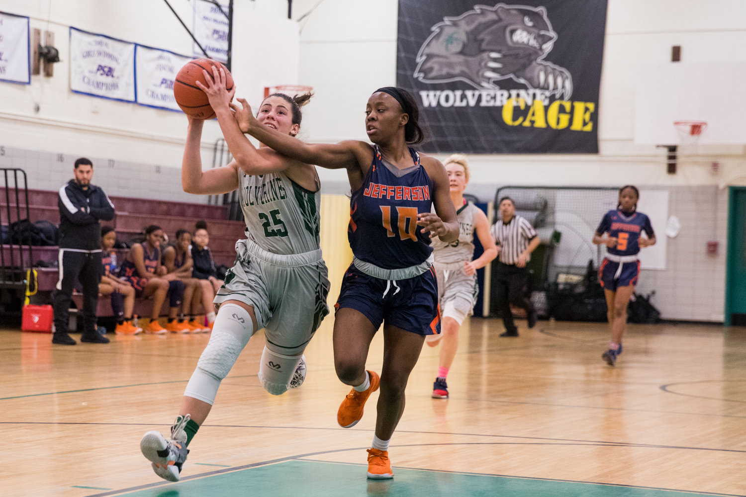 Bronx Science's Carolina Lopez outraces Jefferson's Seraiah Dawson for two of her 16 points in the Wolverines' PSAL playoff victory last week.