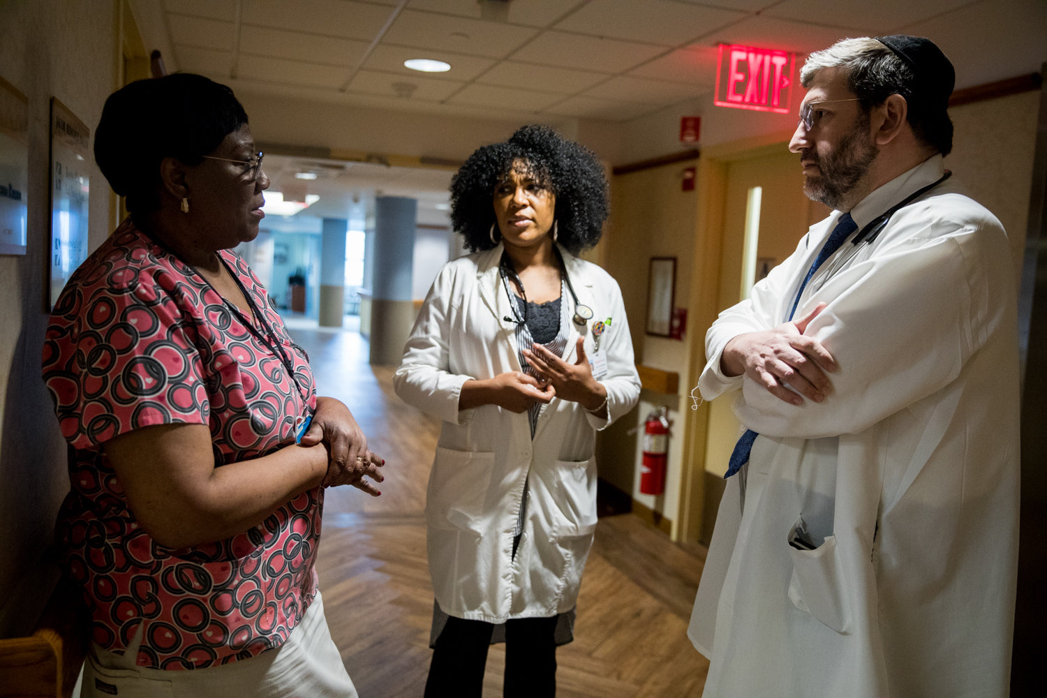 Patricia Salifu, a licensed practical nurse at the Hebrew Home at Riverdale, left, talks with nurse practitioner Sebrina Henderson and medical director Dr. Zachary Palace about a care plan for one of the Palisade Avenue facility's residents.