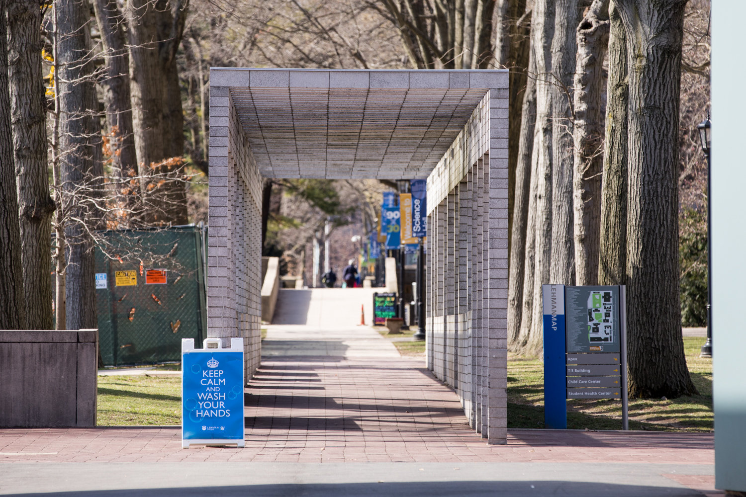 A sign reads 'Keep calm and wash your hands' on Lehman College's campus, which is closed like other CUNY campuses in response to the coronavirus outbreak. Students and faculty are expected to transition to online learning March 19.