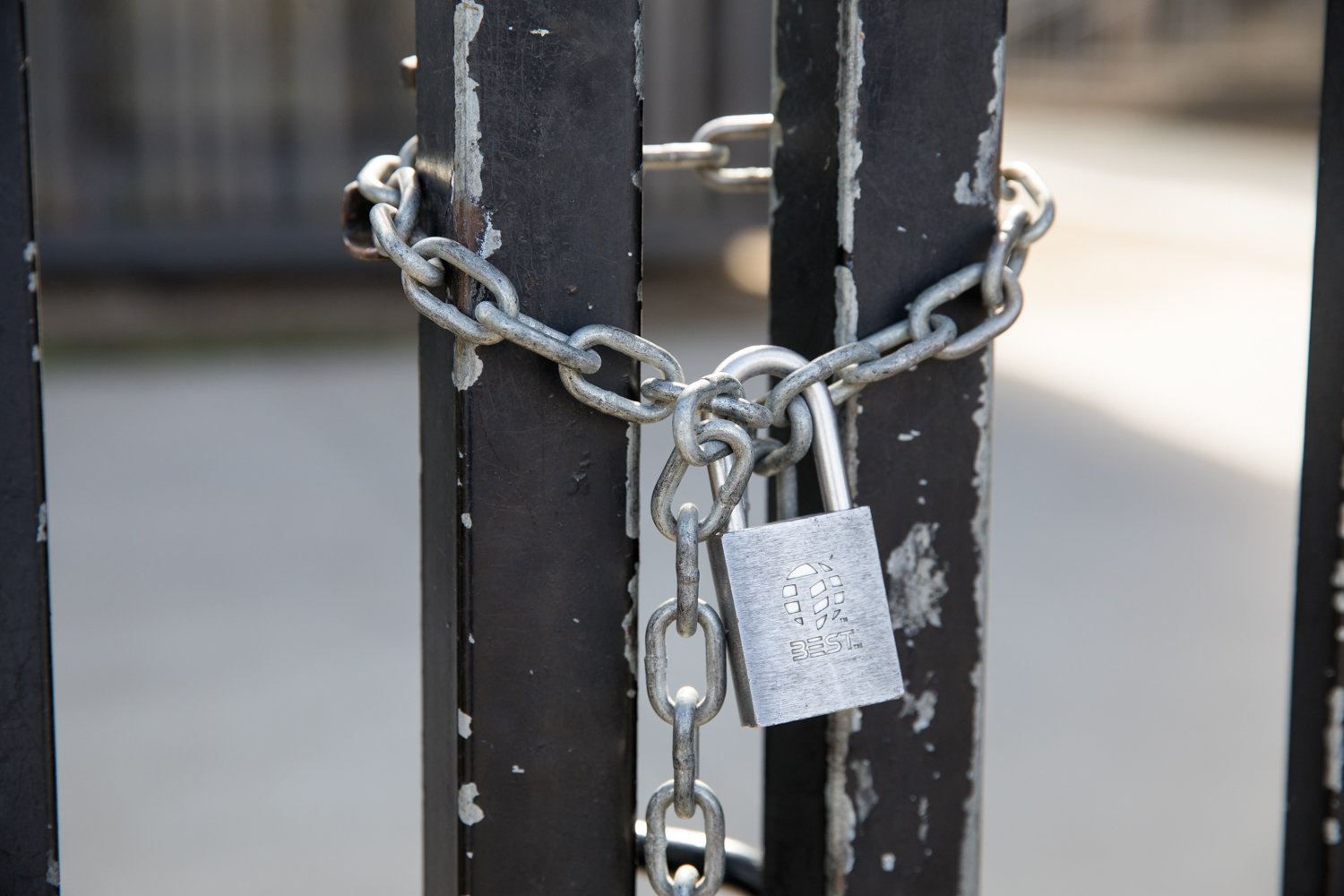 A lock and chain seals off a gate to Lehman College days after the campus was closed in response to the coronavirus outbreak.