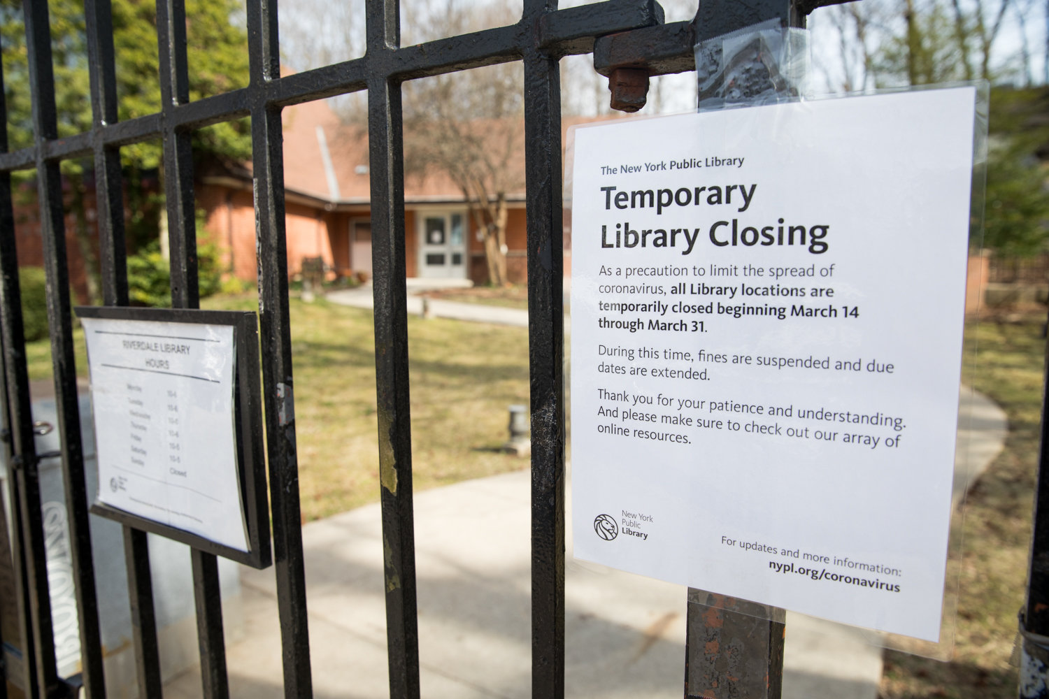 A sign announces the temporary closure of the Riverdale Library in response to the coronavirus outbreak. The library is scheduled to reopen March 31.