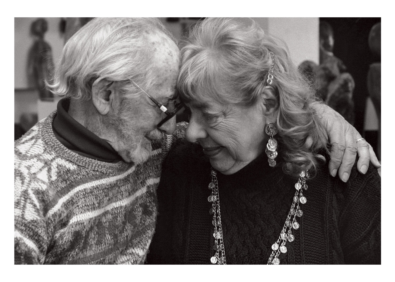 Bernie and Honey, artists who care as much about each other as they do their work, warmly embrace each other for a portrait by Robert Fass, part of the series 'As Long As We Both Shall Live.'