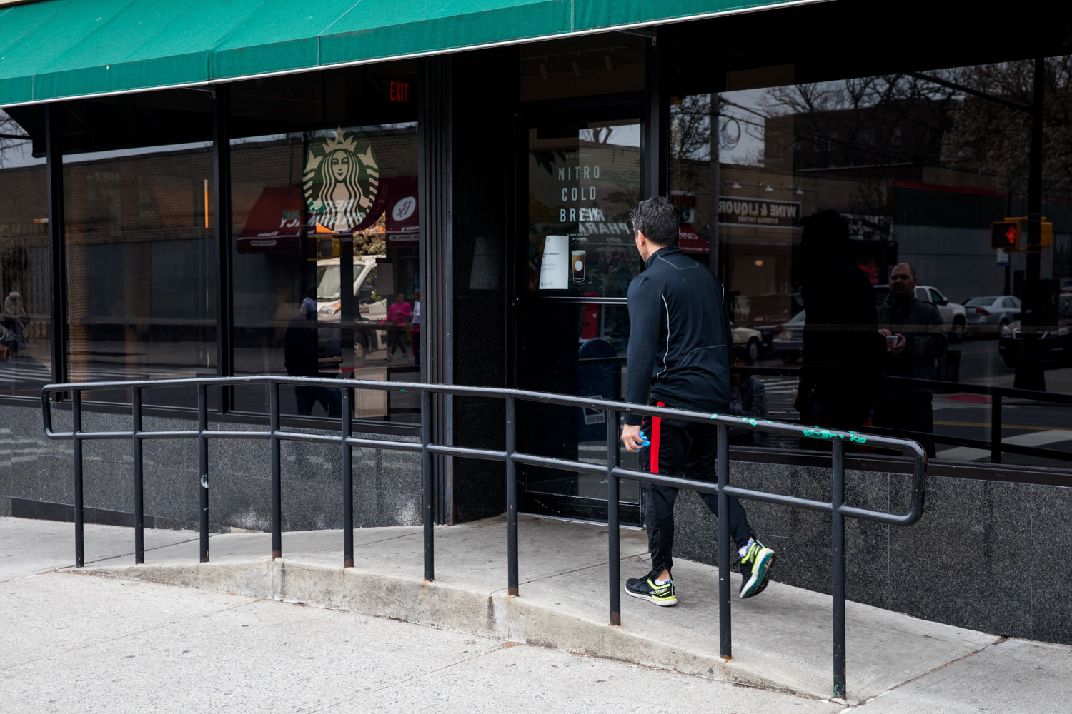 A pedestrian walks to Starbucks on Johnson Avenue to find it has closed, a corporate victim of the coronavirus pandemic.