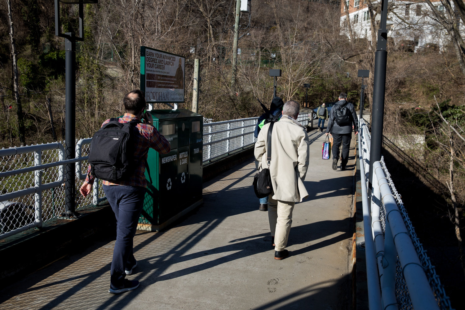 Commuters walk toward the north end of Edsall Avenue after climbing the stairs from the Spuyten Duyvil Metro-North station. It's a journey after the trip that some cannot take because of disabilities, and a lack of elevator at the station.
