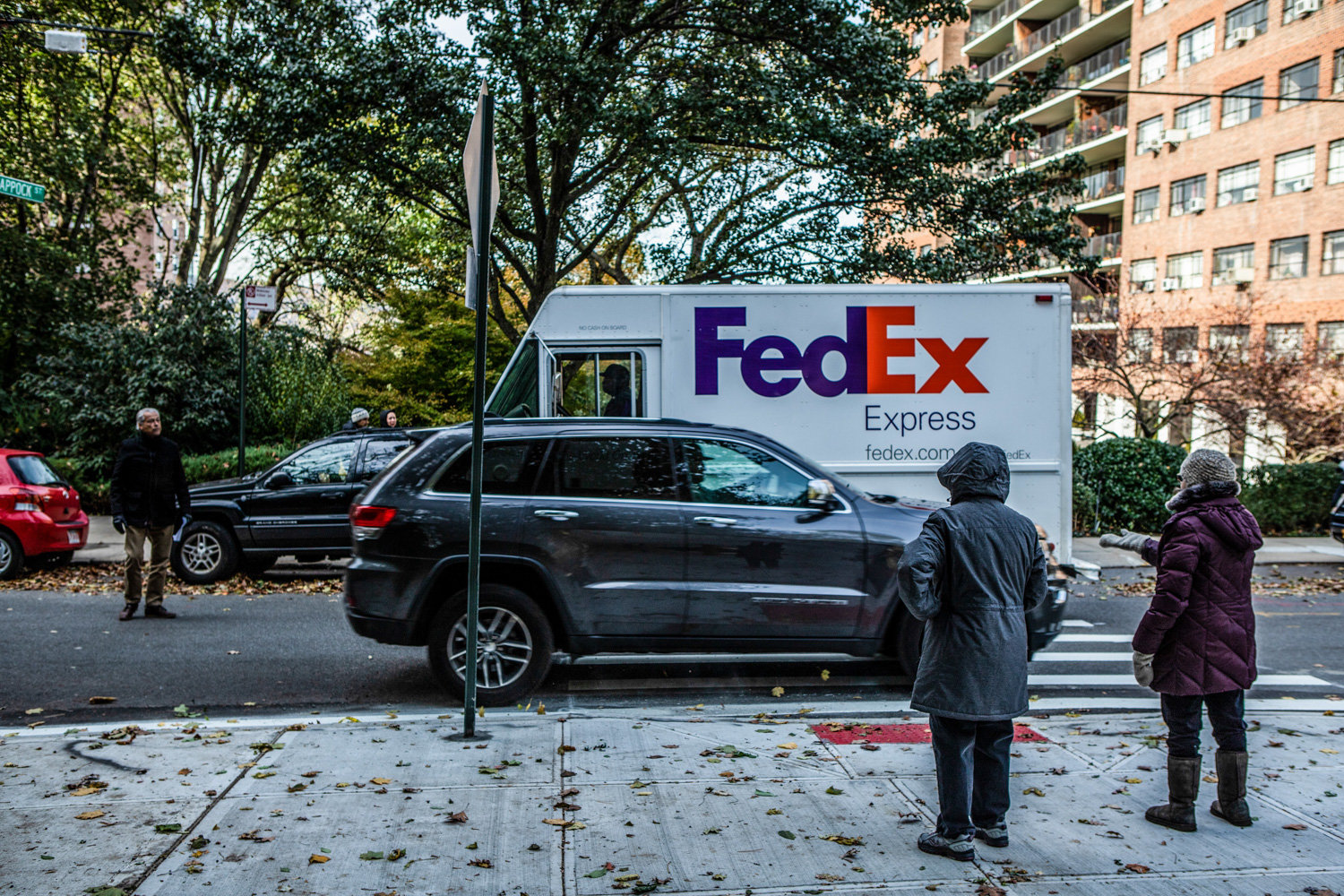 During a meeting with DOT's Bronx borough commission Nivardo Lopez last year, Michael Harrington, left, asks a FedEx truck to demonstrate how narrow Palisade Avenue is as a result of the curb extension.