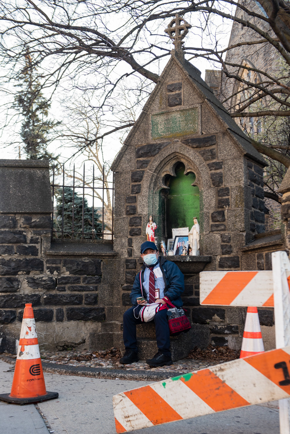 Frida Sterenberg photographed an MTA worker sitting on a stoop outside the Episcopal Church of the Mediator during a walk around the neighborhood, which is part of an ongoing project about how the area has changed as a result of the state's shutdown in response to the coronavirus pandemic