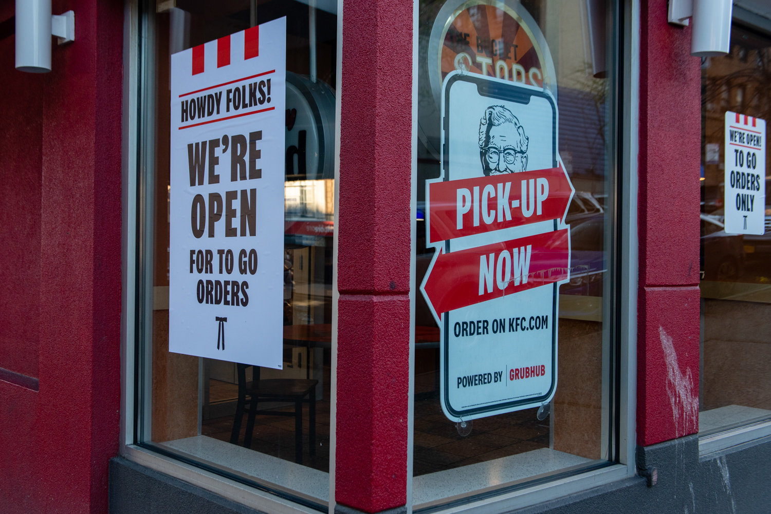 Signs inform passersby that the Kentucky Fried Chicken on Broadway is open for to-go orders. The partially closed business is a familiar sight in the weeks since the state's shutdown in response to the coronavirus pandemic, which Frida Sternberg captured for her project documenting the new normal.