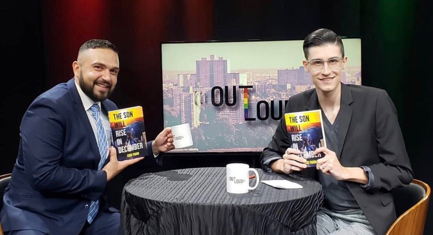 Anthony Parker, right, sits down with local author Eddie Pabon, left, to talk about his novel 'The Son Will Rise in December,' for the 'Out Loud' television program on BronxNet.