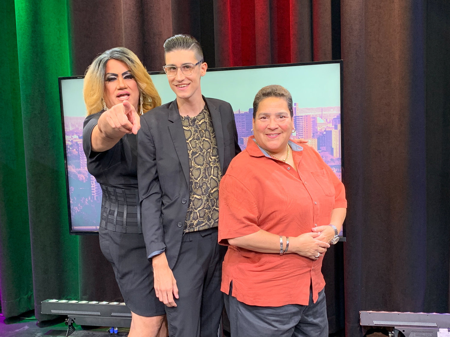 'Out Loud' host Anthony Parker, center, stands with local personality Apollonia Cruz, left, better known as 'Queen of the Bronx,' as well as Audrey DeJesus, right, an entrepreneur who hopes to open a gay bar in the borough.