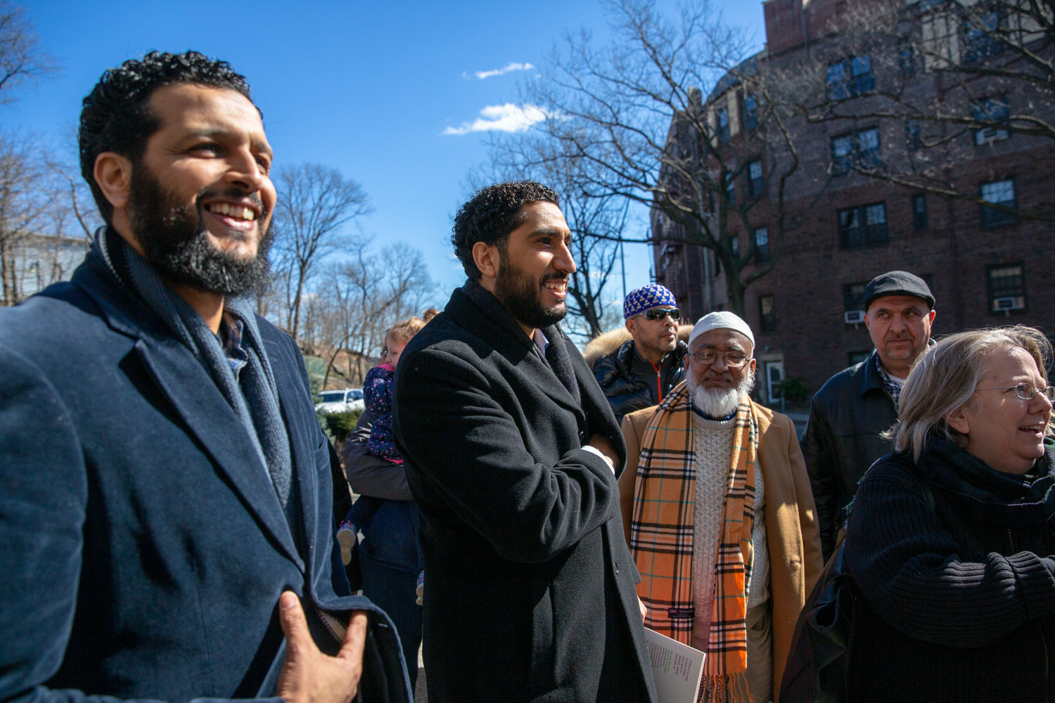 Imam Yassine Taoufik, center, who leads the Abrar, a mosque, in Kingsbridge, attends a vigil last year. Taoufik has found the sense of community among his congregants has grown stronger in the time since the coronavirus pandemic began.