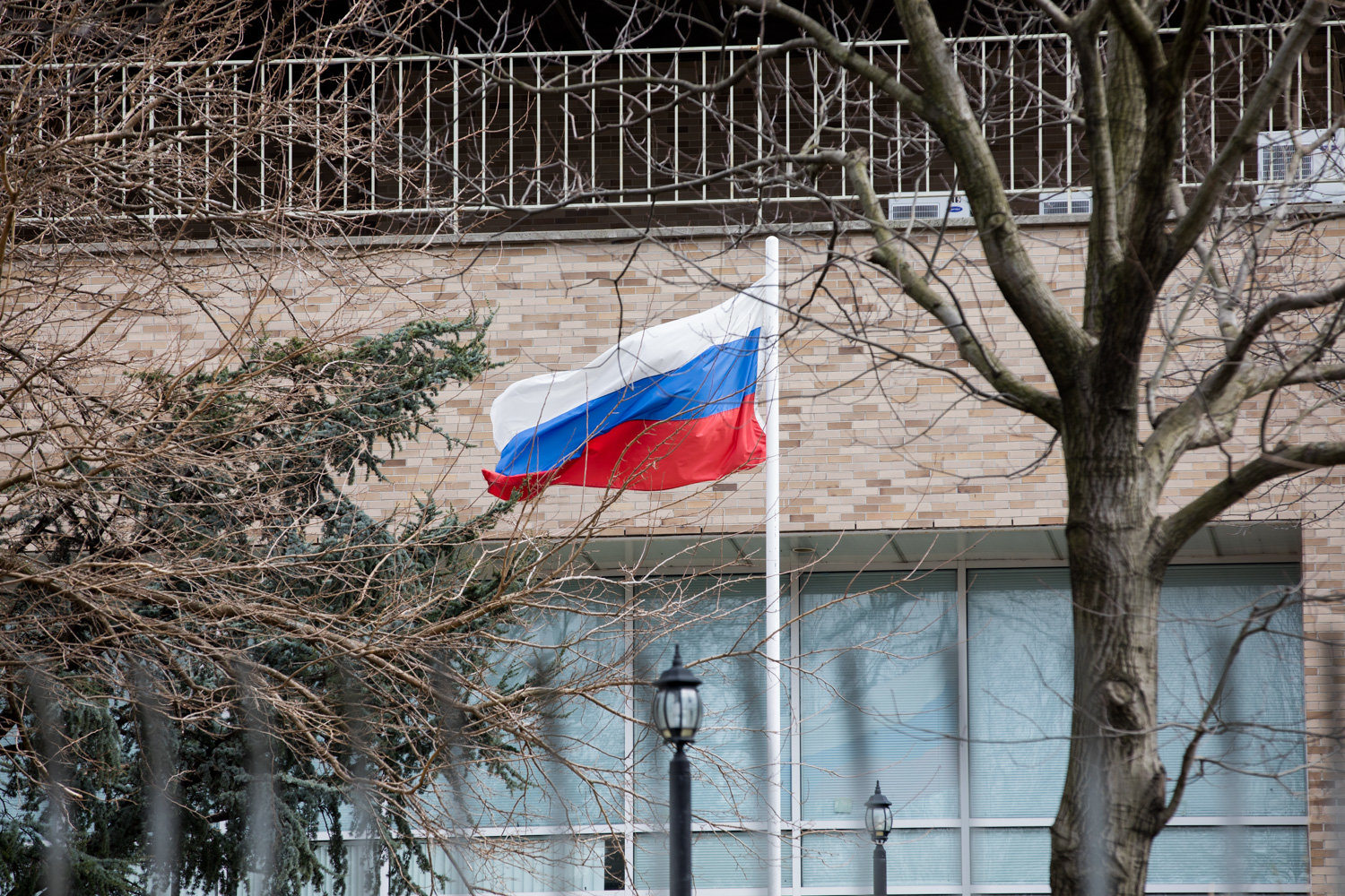 The Russian flag waves in the wind in front of the Russian Mission on Mosholu Avenue.