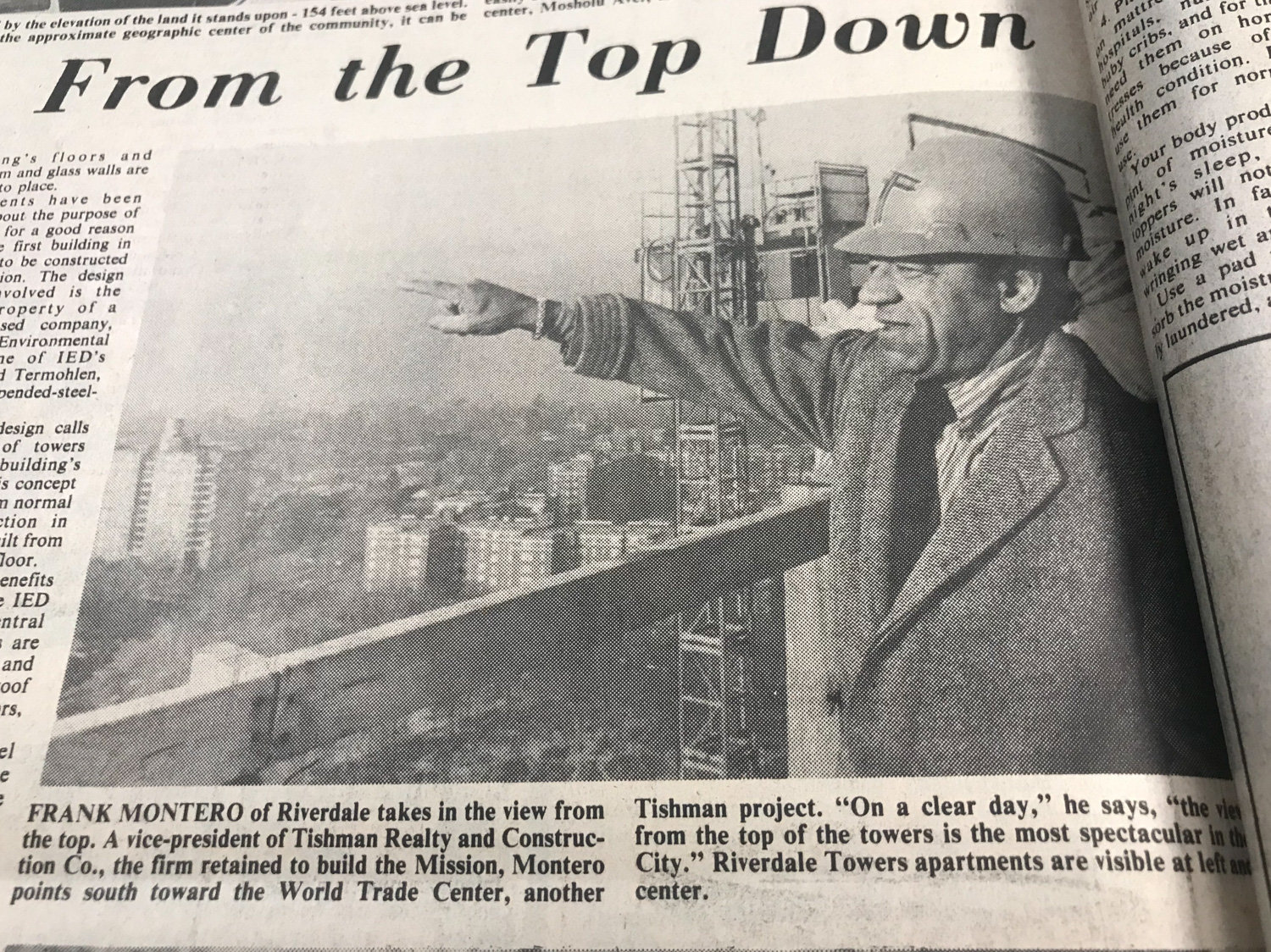 Frank Montero, a vice president with Tishman Realty and Construction Co., points from the barren towers of the Russian Mission in North Riverdale to another one of his company's projects, the World Trade Center towers 15 miles south in Manhattan. He was joined on this particular trip to the Mosholu Avenue construction site by Riverdale Press features reporter Sol Solomon.