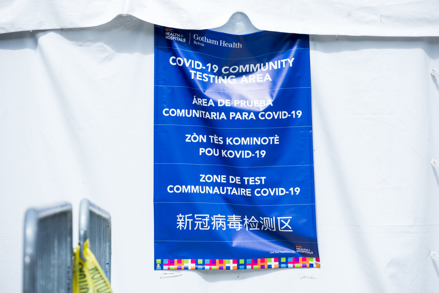 A sign on a tent informs people that NYC Health + Hospitals/Gotham Health, Belvis, is a diagnostic testing area for the coronavirus that causes COVID-19 — one of six testing centers in the borough.