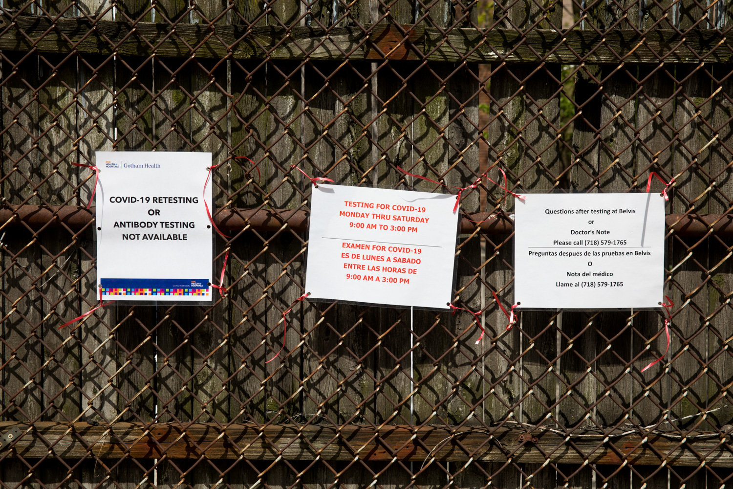 Signs posted outside of NYC Health + Hospitals/Gotham Health, Belvis, clarify hours of operation and what kinds of diagnostic tests are available for the coronavirus that causes COVID-19.