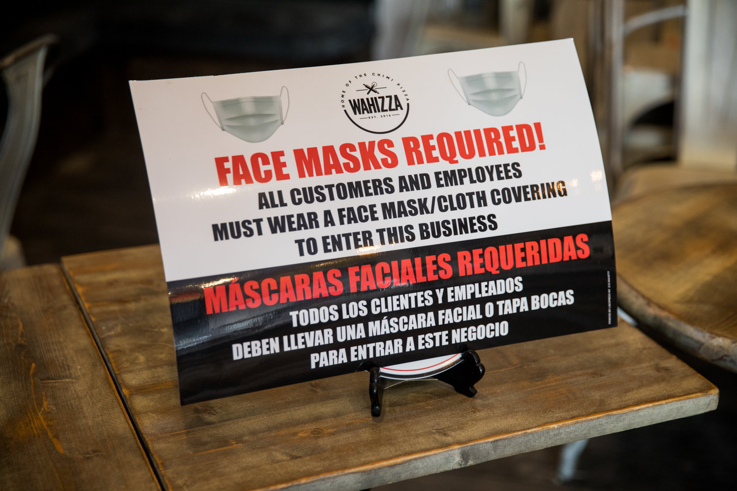 A sign informs people that masks are required inside Mon Amour Coffee & Wine as a result of the coronavirus pandemic.