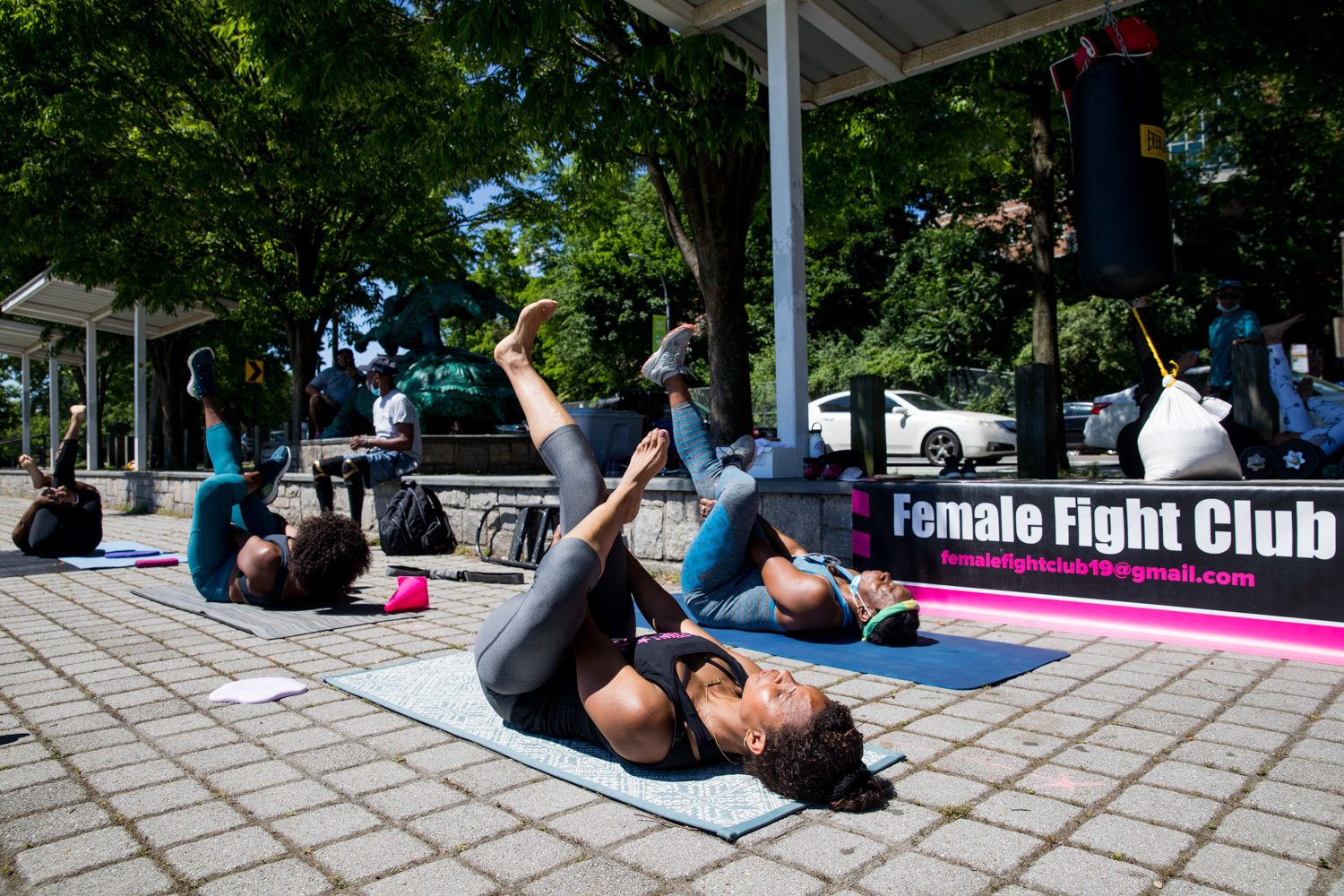 Members of Female Fight Club, a fitness group, cools down with yoga at the end of a workout routine in Van Cortlandt Park. Johanna Edmondson founded the club in the early days of the coronavirus pandemic.