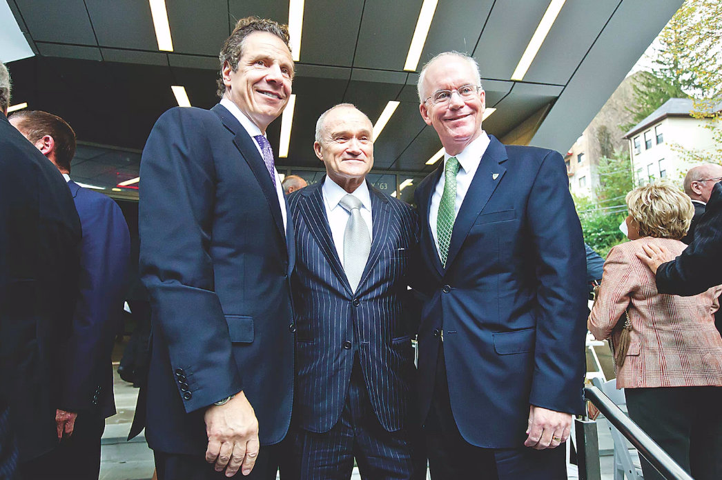 Former New York Police Department commissioner Raymond Kelly, center, is joined by Gov. Andrew Cuomo and Manhattan College president Brennan O'Donnell at the 2014 dedication of the Raymond Kelly Student Commons on Waldo Avenue.