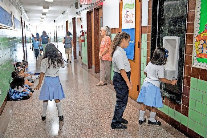 "St. John's School was the only Catholic elementary school left in Kingsbridge. Now that its doors have closed, students and parents will have to look elsewhere — including ""up the hill"" — to continue their education."