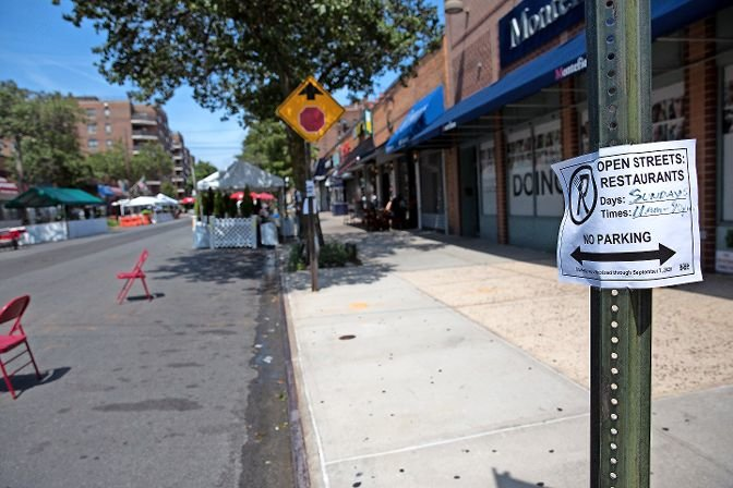 A sign details parking restrictions for Open Streets Sundays, a new program from the Kingsbridge Riverdale Van Cortlandt Development Corp., which permits restaurants and artists to set up socially distanced dining areas and stands each week through October.