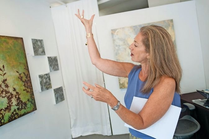 Lisa Cooper, owner of Elisa Contemporary Art, discusses an exhibit from 2017. While the gallery has been closed since March, it's reopened to present 'Dive In 2020,' a new exhibit featuring calm, contemplative and joyful pieces by artists Carol Bennett and Martha Hughes. It's on display through Sept. 2.
