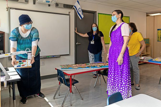 Before the school reopened Sept. 8, Kinneret Day School educators had to train how to operate the camera systems for students learning from home. But most of Kinneret's students will learn in the classroom five days a week.