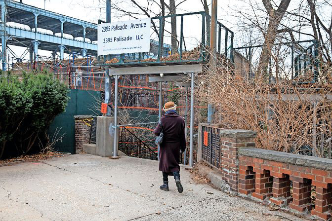 A woman walks toward Bradley Terrace, a step street Spuyten Duyvil activist Stephanie Coggins had hoped to ceremonially co-name after the former Villa Rosa Bonheur apartment building nearby, and its developer, John J. McKelvey Sr. However, Councilman Andrew Cohen ended that push by telling Coggins and other community groups no.