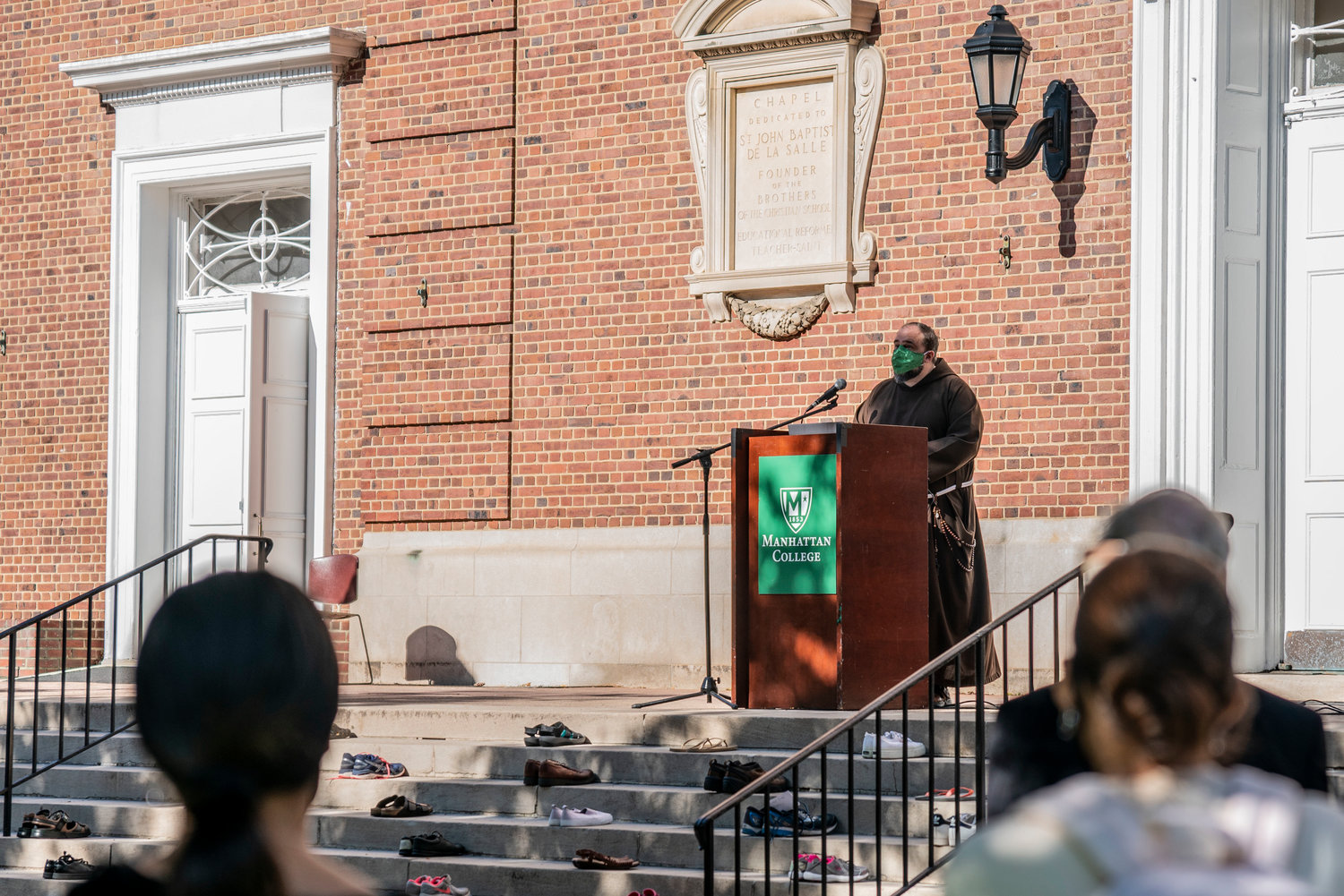 "Father Thomas Franks addressing the ""Shoe Strike"" crowd at Manhattan College."