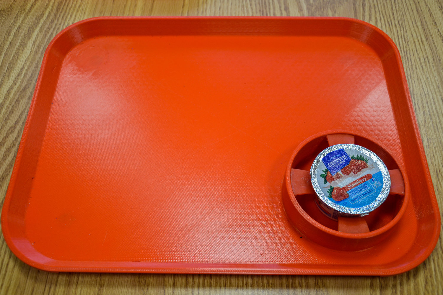 Designed by speech pathologist Ilana Herman, the independent feeding tray features four flaps attached to a molded cup and is meant to help those struggling with neurological and orthopedic injuries eat independently. The tray is still in development. .