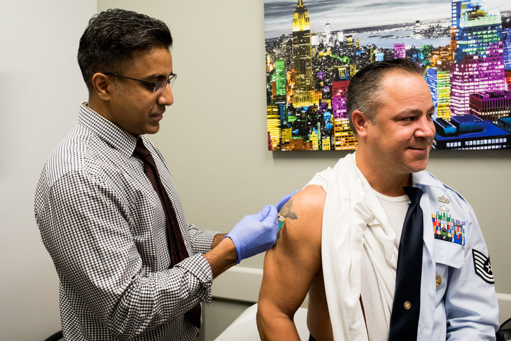 Thomas Mullen gets a free flu vaccine from Dr. Jijoe Joseph in 2018. City health officials are saying this could be the most important flu vaccine people ever receive as the common cold, flu, and the coronavirus all circulate.