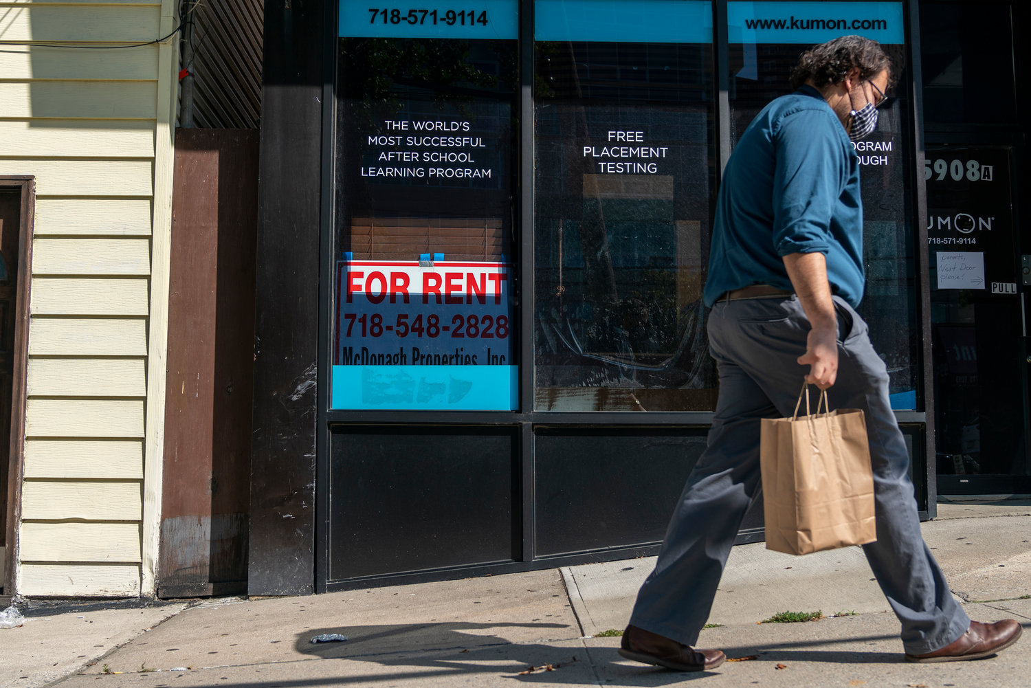 A man walks past the 'for rent' sign on the old Kumon center's window on Riverdale Avenue. The sign might be misleading, however, as this Kumon franchise didn't go out of business — It just moved next door.