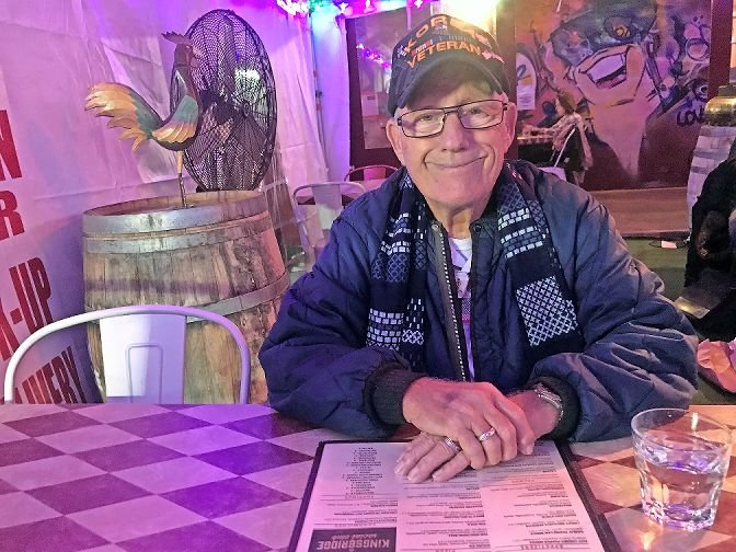 In what would be his first-ever trip to the Bronx in all of his 87 years on the planet, Richard Hinman gets ready to enjoy some grub at the Kingsbridge Social Club with his son, Riverdale Press editor Michael Hinman.