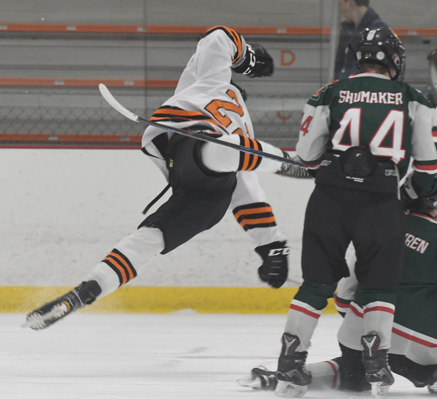 TAKES A TUMBLE  — Rome Free Academy defenseman Danny Mecca goes flying after he was swept off his feet during a rush into the offensive zone early in Friday night's 4-1 in over Fulton at Kennedy Arena. Mecca scored the team's first goal on a power play in the first period.