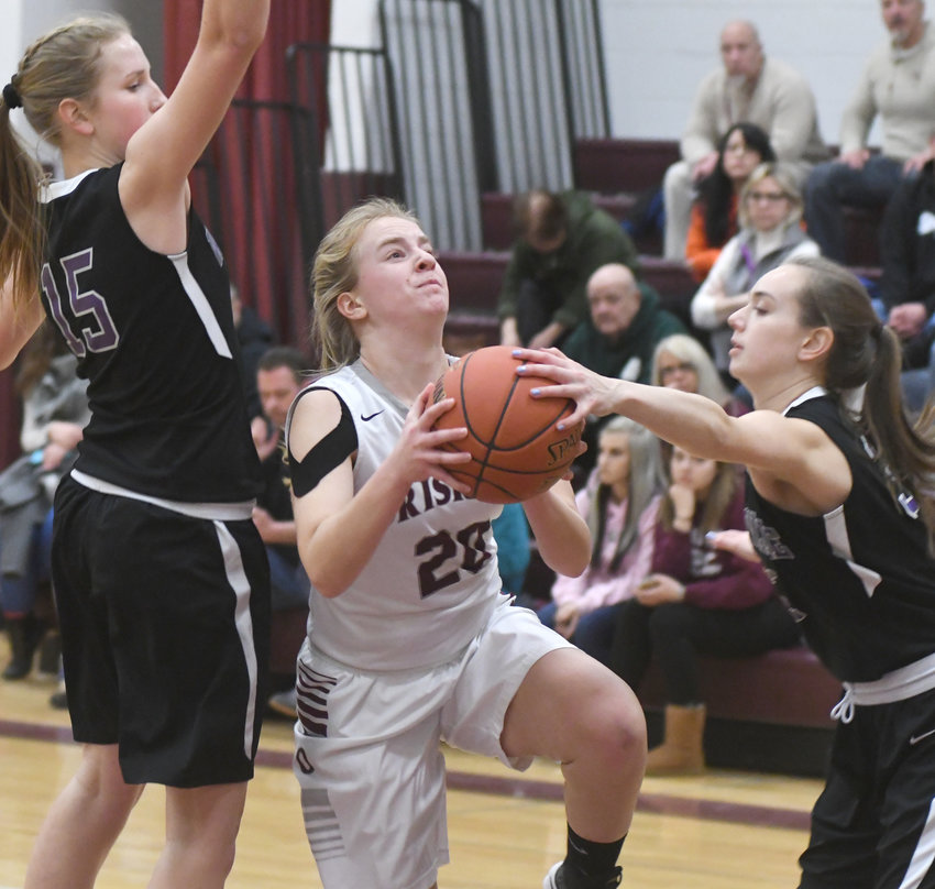 DOUBLE TEAM — Oriskany's Aeron Hamm goes up for a shot and is defended by Waterville's Molly Williams, left, and Kathleen Gallagher on Tuesday night. Hamm led the Redskins with 11 points and seven rebounds but Waterville won 71-36. Williams and Gallagher scored 11 and 10, respectively.