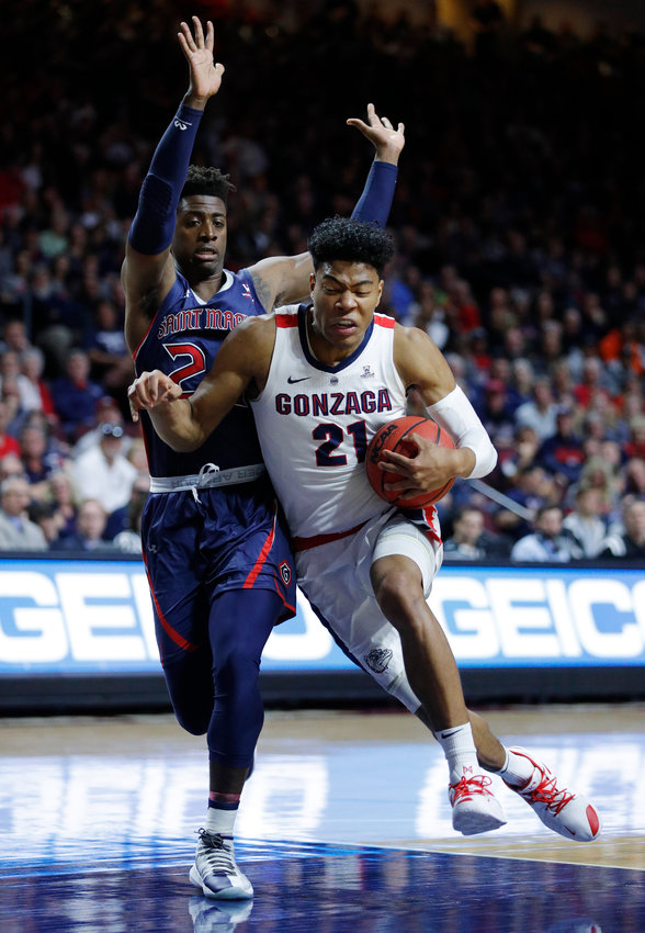 NO. 1 IN THE WEST — Gonzaga's Rui Hachimura drives into St. Mary's Malik Fitts during the West Coast Conference championship game last Tuesday in Las Vegas. The Zags los to St. Mary's, but on Sunday they were named the No. 1 in the NCAA West Region.