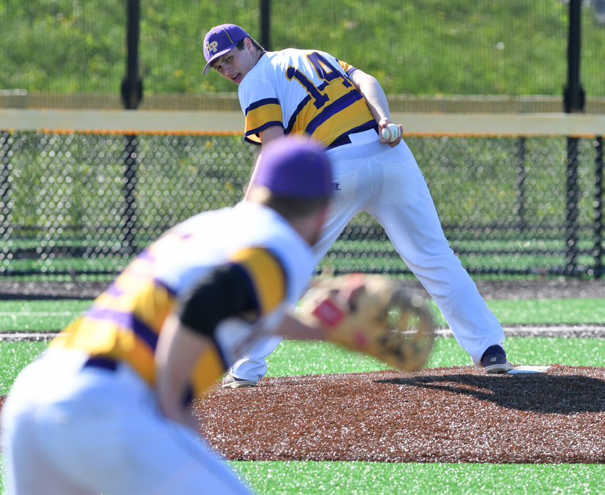 KEEP HIM CLOSE — Holland Patent pitcher Conner Stalker looks back to first base while Rob Maciol holds a runner on. The Golden Knights came back to beat Clinton 9-8 Friday at Hamilton College.