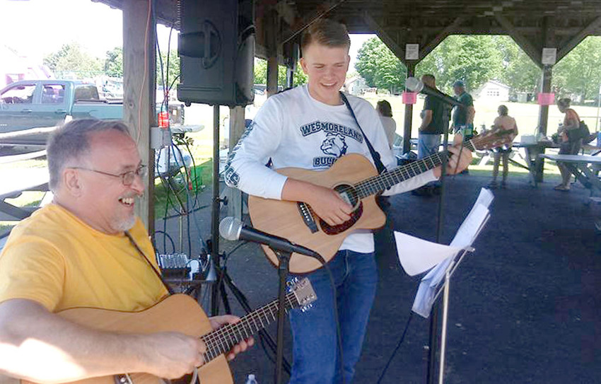 MAKING MUSIC — John Lauber and Ben Christensen perform at the Westmoreland Town Pool fundraiser on June 2 in Westmoreland Town Park. Organizers said it was the best-attended fund-raiser for the pool, and it raised the most funds to-date.  (Photo submitted)