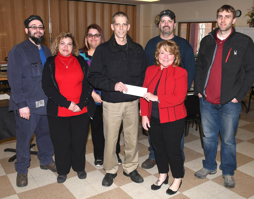 KRIS-TECH CARES —Kris-Tech employees, from left, Glenn Rothe, Geanna Fezza, Nadine Almond, Eric Pietrowski, Jamie McNett and Jason Higley, all representatives of the CARES program at Kris-Tech, present Ava Dorfman Center Executive Director Susan Streeter a $1,000 check. The company donated $1 to the fund for every 1,000 pounds of copper that was shipped.  (Sentinel photo by John Clifford)