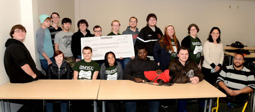 GAMING CLUB DONATES —  The Mohawk Valley Community College Strategic Gaming Club presents a check for $2,100 to the Children's Miracle Network (CMN) at St. Luke's Hospital, after a gaming marathon fundraiser. In front, from left: Kyle White, Diana Feola, Raymond Kent, Tatyana Harvey, Leslee Waters, Edin Muslic, Antonio Grieco. In back, from left: Jon Speziale; Justin Fleming; Justin Moore; Bryant Platt; Trey Cornish; Kevin Kirk, club vice president; Andrew Clanton, club secretary; Chris Abbe, club president; MVCC Assistant Professor Amanda Miller, advisor; MVCC Assistant Professor Melissa Barlett, advisor; and Andrea MacDiarmid, CMN coordinator.  (Photo submitted)