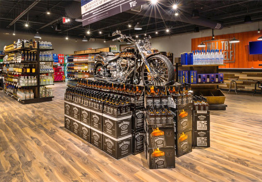 SMOOTH RIDE — This combination Harley-Davidson motorcycle and Jack Daniels' whiskey display shows one of several liquor products available at Tin Woodsman's Flask liquor store in Chittenango's Emerald City Plaza. The store is celebrating its grand opening this week and will have tastings each weekend in December to promote its products.  (Photo submitted)