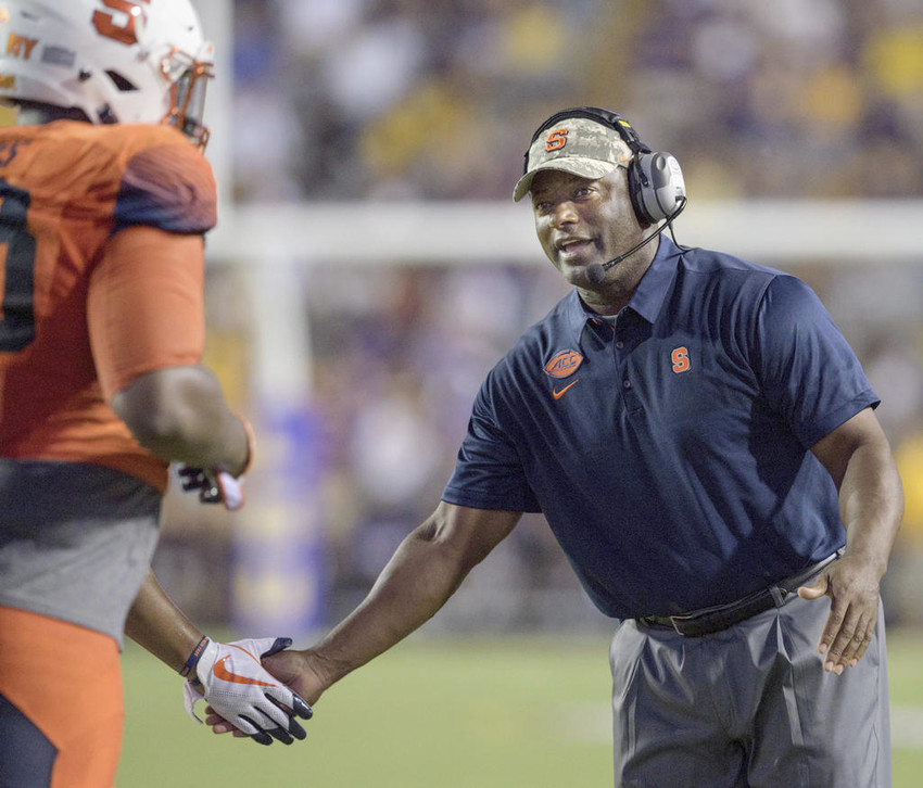 TOUGH TASK AHEAD — In this Sept. 23 photo, Syracuse coach Dino Babers celebrates a touchdown with his team against LSU in the second half of an NCAA college football game in Baton Rouge, La, Syracuse has beaten one ranked team in the short tenure of coach Dino Babers. The Orange have a chance to notch another when No. 2 Clemson comes to town on Friday night.  (AP File Photo)