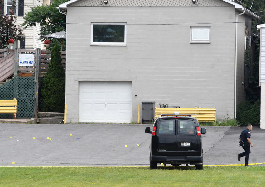 FATAL SHOOTING — The Rome Police Forensics Unit is still investigating this morning's homicide in the back parking lot of Sammy G's along Woodrow Avenue.  Some yellow evidence markers were still visible before 11 a.m.  (Sentinel photo by John Clifford)