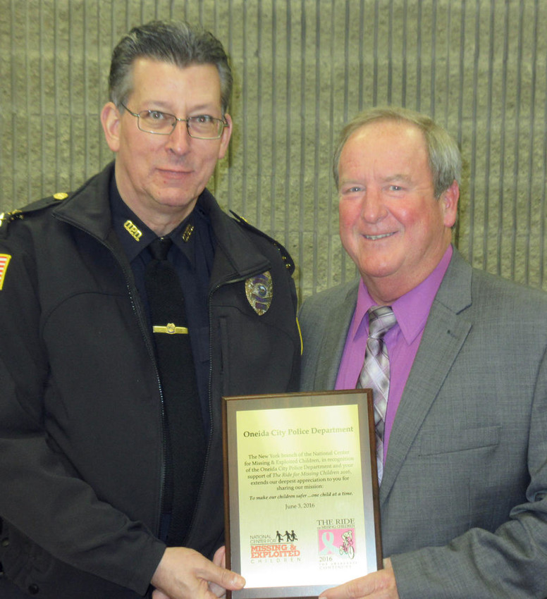 THANKS FOR SUPPORT — Acting Oneida City Police Chief Lt. Paul Thompson, left, receives a plaque of thanks from former Troop D Public Information Officer Jim Simpson at Tuesday evening's Common Council meeting. The Oneida police department has supported the Ride for Missing Children since it began in 1997.  (Sentinel photo by Roger Seibert)