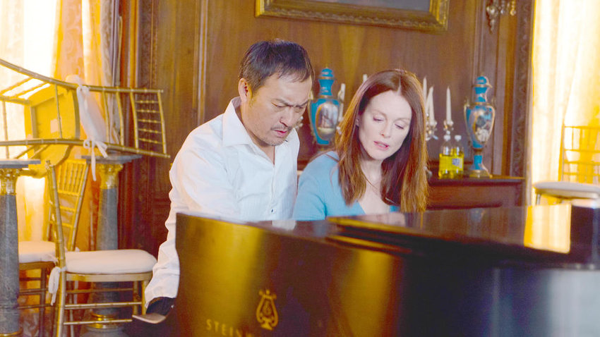 "STRIKING THE RIGHT NOTE — Ken Watanabe and Julianne Moore in a scene from ""Bel Canto.""  (Photo courtesy Screen Media Films)"
