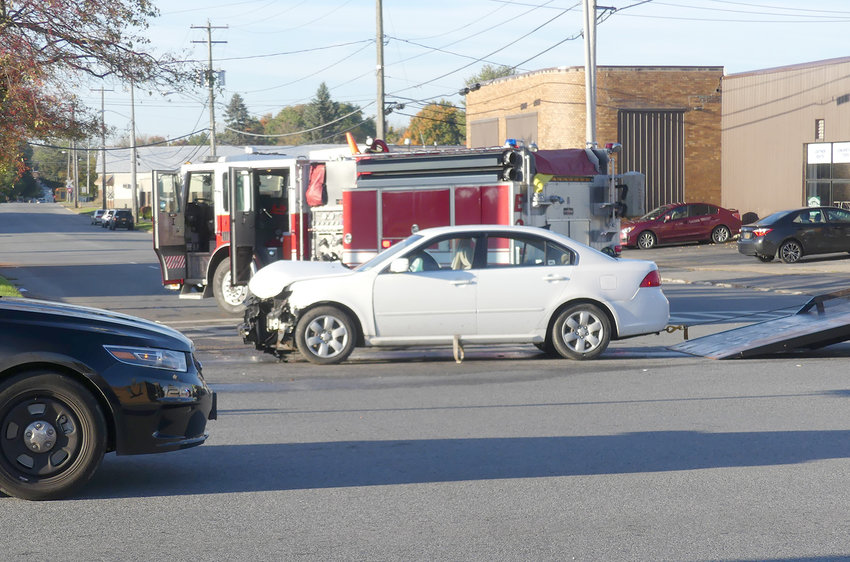 FRONT END DAMAGE — A white car sits in the intersection of Erie Boulevard and South George Street after crashing into the back of another vehicle shortly after 8 a.m. today.