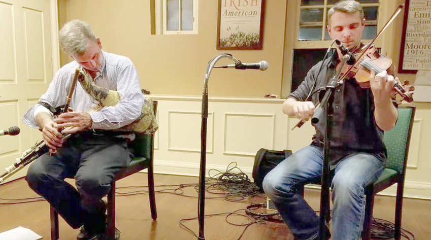 IRISH INSTRUMENT — Uilleann pipe player Jerry O'Sullivan, left, will perform Sunday in Utica.