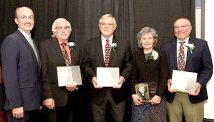 HALL OF FAMERS — Mohawk Valley Community College's Class of 2018 Hall of Fame inductees receive plaques at a ceremony held on Oct. 29, at MVCC. From left: MVCC President Randall VanWagoner and inductees Arthur Friedberg, Dr. Robert B. Jubenville, Norayne W. Rosero, and Bill Perrotti.