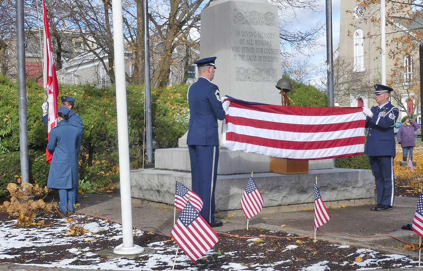 STARS AND STRIPES — Rome Labs personnel fold up the flag during the Veterans Day ceremony in Veterans Memorial Park on Sunday, following welcoming remakes by Mayor Jacqueline Izzo.