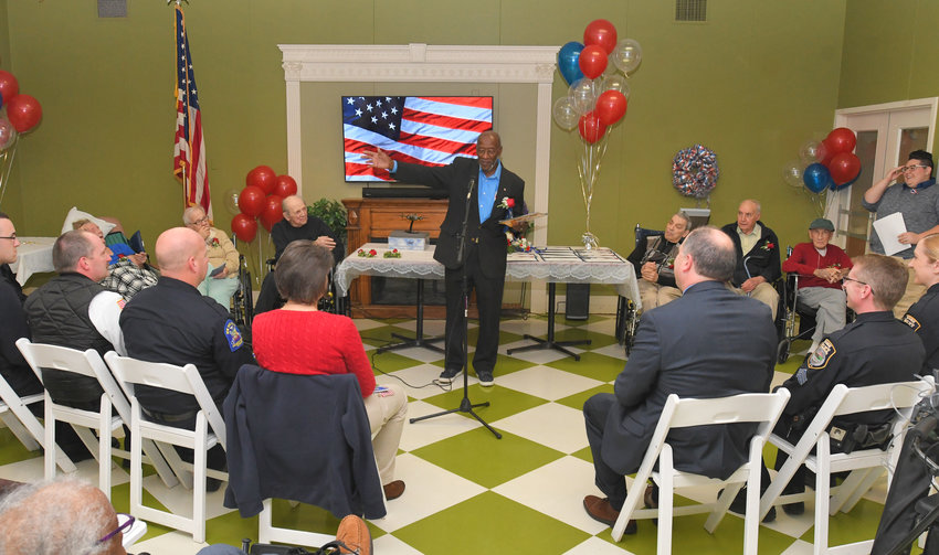 RECALLING WORLD WAR II —Herbert Thorpe talks about his service as a Tuskegee Airman during World War II with residents and visitors at a Veterans Day observance at the Colonial Park Nursing and Rehabilitation Facility, 950 Floyd Ave., on Monday.