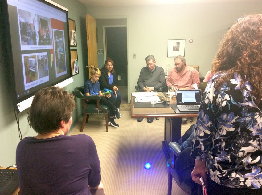ROBOTICS DEMONSTRATION — Student Andrew Litwak, seated in the background at left, demonstrates coding and programming of a Sphero robotic device during the Vernon-Verona-Sherrill Board of Education meeting this week.
